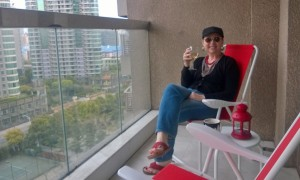 Enjoying my new patio chairs from Ikea on our balcony.