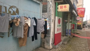Sundays are laundry day and clothes are hung randomly all over the sidewalks to dry.