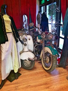 Classic Lambretta scooter on display with fashion art