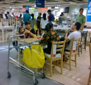 Family time--Enjoying picnic in dining room section at Ikea