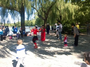Ladies in Red dancing for the crowds in Beihai Park