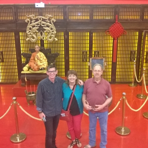 Thom, Patti & Larry pose in front of the Kung Fu boy at Red Theater in Beijing