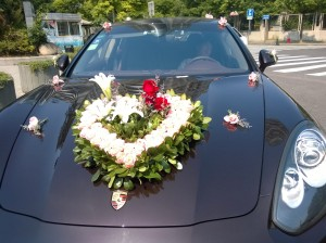 Wedding car is decked out with floral hood ornament