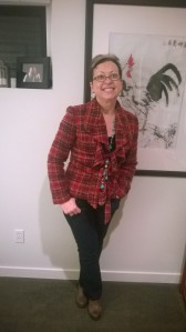 Plaid jacket accented with turquoise long silver necklace