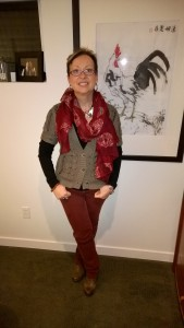 60's Throwback with sweater vest, skull scarf and burgundy jeans