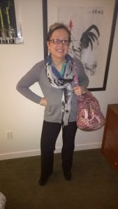 Travelling woman-all you need is a scarf and necklace and pretty overnight bag!