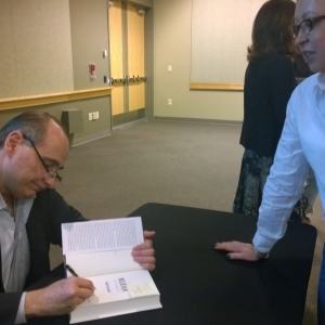 David Axelrod signing his book for me,  Very smart and funny guy.