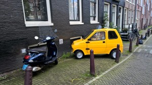 Scooter or mini car? Both have about the same room.