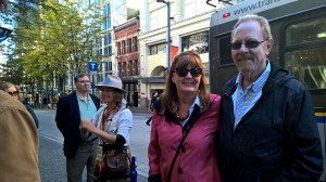 Patti and Larry enjoying Leni's stories on the walking tour of Gastown