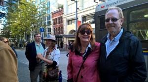 Patti and Larry enjoying Leni's stories on the walking tour of Gastown