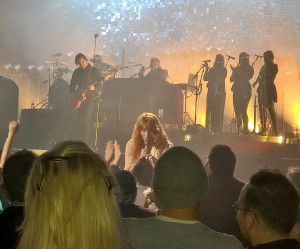 Florence greeted the front row with flowers.