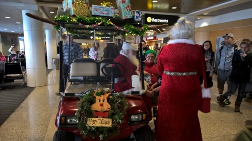 Santa mobile cart with Mrs. Claus and elf sidekicks at SEATAC